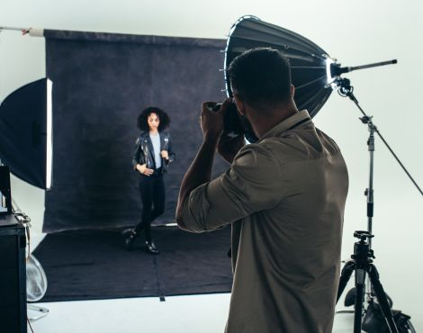 Photographer Doing A Photo Shoot In A Studio